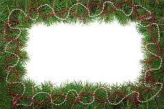 圣诞节框架由用小珠装饰的冷杉分支做成被隔绝在白色背景 库存照片