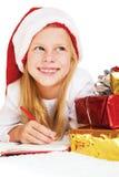圣诞节梦想 写信的小女孩给圣诞老人 免版税库存照片