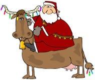 圣诞节母牛他的圣诞老人 库存图片