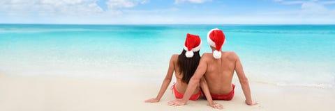圣诞节海滩假期假日夫妇横幅 免版税库存照片