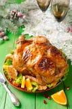 圣诞节烤鸡用桔子 免版税库存图片