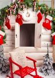 圣诞节照片有空的窗口和装饰的一点房子 库存图片
