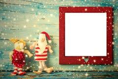 圣诞节照片框架卡片圣诞老人和驯鹿 免版税库存照片