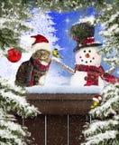 圣诞节猫&雪人 免版税图库摄影