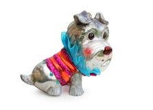 圣诞节玩具作为在白色的一条狗 免版税库存照片