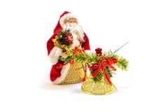 圣诞节玩具圣诞老人和金响铃 免版税库存照片