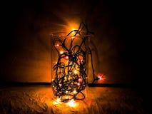 圣诞节球特写镜头从圣诞树的,被弄脏装饰的圣诞节,在背景中blured光 库存图片