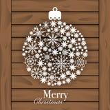 圣诞节球被隔绝的由雪花制成在木背景 图库摄影