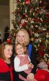圣诞节的三个女孩 免版税库存照片