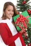 圣诞节的俏丽的女孩 免版税库存图片