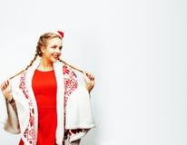 圣诞节的年轻人相当愉快的微笑的白肤金发的妇女在圣诞老人关于 免版税库存图片