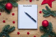 圣诞节的愿望用在一个笔记薄的德语与圣诞节de 库存图片