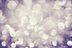 圣诞节的抽象典雅的棕色轻的bokeh照明设备或 免版税库存图片