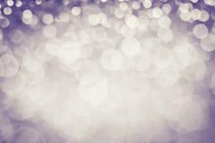 圣诞节的抽象典雅的棕色轻的bokeh照明设备或 库存照片