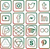 圣诞节的绿色和红色色的社会媒介象 图库摄影