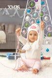 圣诞节的逗人喜爱的女婴 免版税库存照片