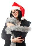 圣诞节盖帽的女商人 免版税库存照片