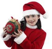 圣诞节相当给女孩穿衣一点 免版税图库摄影