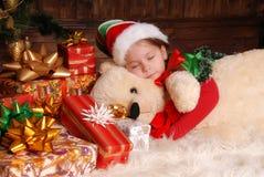 圣诞节矮子的衣服的小女孩 库存照片