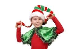 圣诞节矮子衣服的女孩在白色的 免版税库存图片