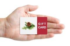 圣诞节礼品券在手中 免版税库存照片