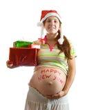 圣诞节礼品孕妇 免版税图库摄影