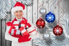 圣诞节礼品帽子藏品圣诞老人妇女 库存图片