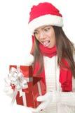 圣诞节礼品开张的当前不快乐的妇女 免版税库存图片