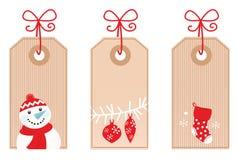 圣诞节礼品红色减速火箭的标签 免版税图库摄影
