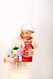 圣诞节礼品红色性感的冬天妇女年轻&# 免版税库存照片