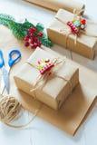 圣诞节礼物和杉木针小树枝在白色背景的 免版税图库摄影
