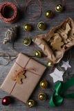 圣诞节礼物响铃和曲奇饼 库存照片
