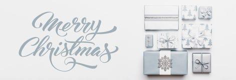 圣诞节礼物横幅 在白色背景隔绝的美好的北欧圣诞节礼物 淡色蓝色色的被包裹的xmas箱子 库存图片