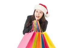 圣诞节礼物的女商人购物 免版税库存照片