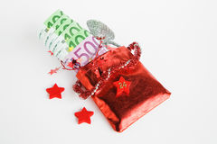 圣诞节礼物,出现日历,与金钱的小袋子 库存照片