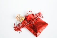 圣诞节礼物,出现日历,与金钱的小袋子 免版税库存图片