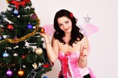 圣诞节神仙的性感的妇女 免版税库存照片