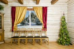 圣诞节空间在农村房子里 库存图片