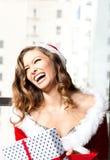 圣诞节笑声美丽的妇女 免版税库存照片