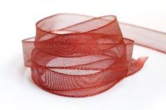 圣诞节红色丝带 免版税库存照片