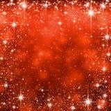 圣诞节红色满天星斗的背景。 免版税库存图片