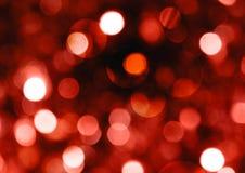 圣诞节红色bokeh闪烁的明亮的抽象背景 免版税库存图片