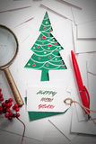 圣诞节背景创造性的设计与纸杉树的 库存照片