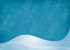 圣诞节背景蓝色随风飘飞的雪 免版税库存照片
