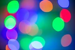 圣诞节背景,图象迷离五颜六色的bokeh defocused光 免版税库存图片
