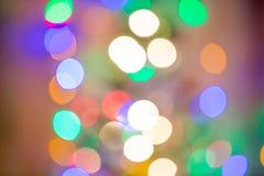 圣诞节背景,图象迷离五颜六色的bokeh defocused光 库存照片