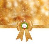 圣诞节背景-在发光的背景的金黄弓 库存图片