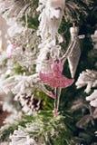 圣诞节芭蕾舞女演员在新年与雪的` s毛皮树计算 免版税图库摄影