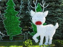 圣诞节英雄计算在g的驯鹿和雪人构成 库存图片
