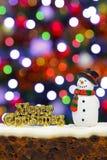 圣诞节蛋糕和雪人 免版税库存照片
